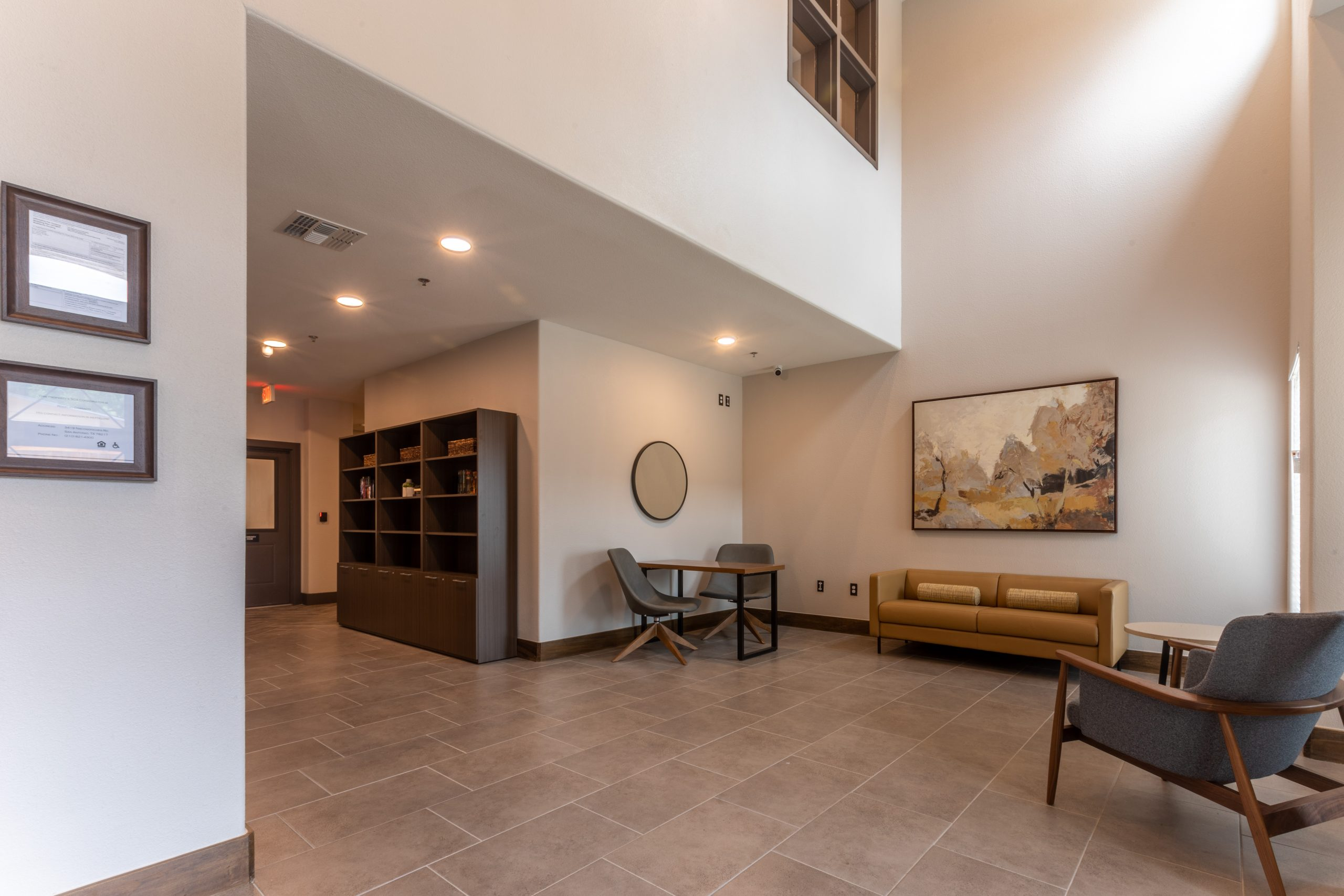 Lobby area with table, chairs and couch