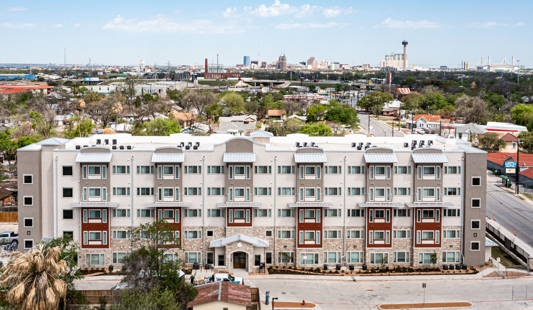 Village at Roosevelt exterior drone image with San Antonio skyline in the back