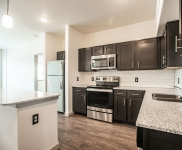 Apartment kitchen with appliance and island