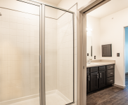 Apartment bathroom walk in shower and bathroom counter